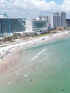 Aerial flyover video beaches, surf and resort hotels in Daytona Beach, Florida